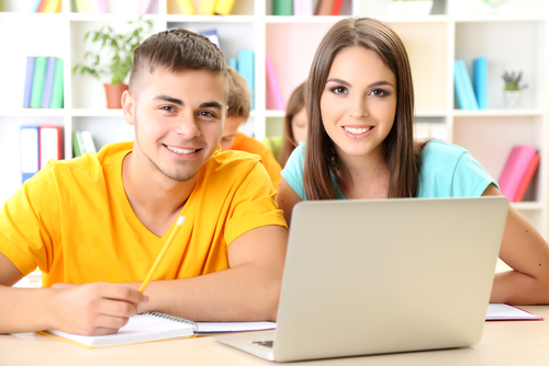 two students with computer shutterstock_145895360